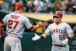 OAKLAND, CA - JUNE 17:  Kole Calhoun #56 of the Los Angeles Angels of Anaheim is congratulated by Mike Trout #27 after hitting a home run against the Oakland Athletics during the third inning at the Oakland Coliseum on June 17, 2016 in Oakland, California. (Photo by Jason O. Watson/Getty Images) *** Local Caption *** Kole Calhoun; Mike Trout