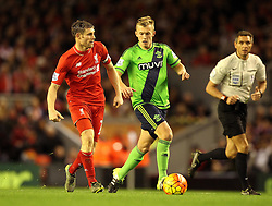 James Milner of Liverpool plays a pass as James Ward-Prowse of Southampton puts him under pressure - Mandatory byline: Robbie Stephenson/JMP - 07966 386802 - 25/10/2015 - FOOTBALL - Anfield - Liverpool, England - Liverpool v Southampton - Barclays Premier League