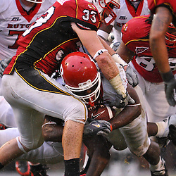Sep 26, 2009; College Park, MD, USA; Rutgers running back Jourdan Brooks (39) is tackled by Maryland linebacker Alex Wujciak (33) during the first half of Rutgers' 34-13 victory over Maryland in NCAA college football at Byrd Stadium.