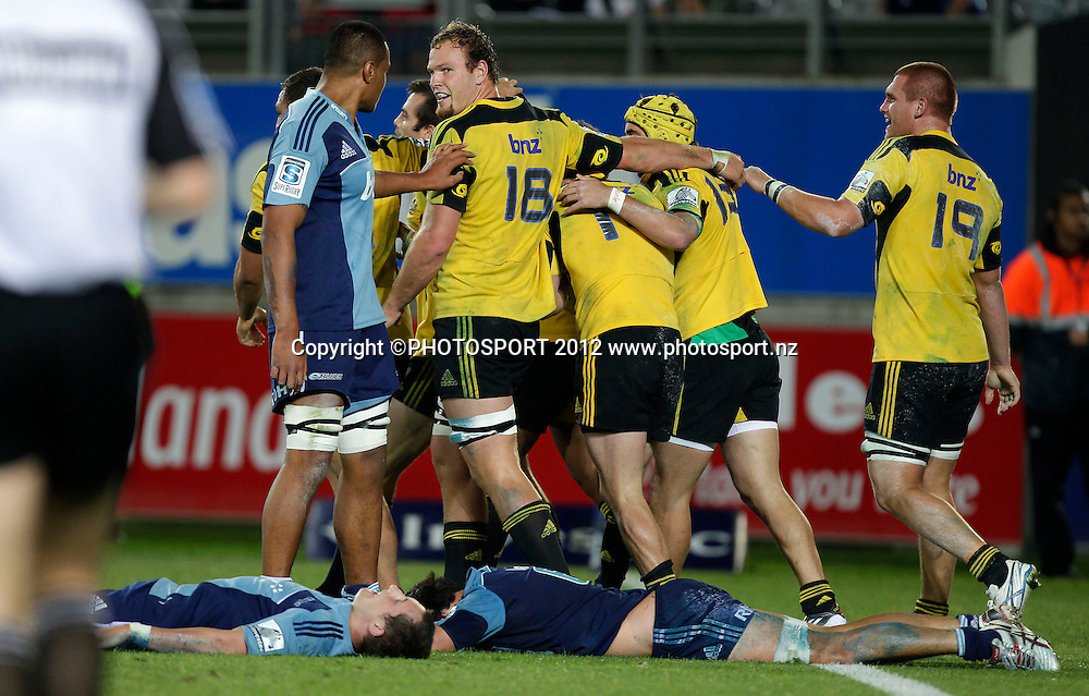 James Broadhurst and Hurricanes players celebrate the winning try during the Super Rugby game between The Blues and The Hurricanes at Eden Park, Auckland New Zealand, Friday 23 March 2012. Photo: Simon Watts / photosport.co.nz