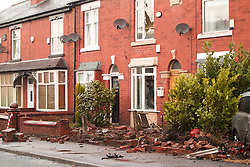 © Licensed to London News Pictures . 08/02/2013 . Salford , UK . Damage caused to several houses in a terrace as a consequence of the collision . The scene on Leigh Road where a multi-vehicle pile up killed two , sparked a fire and damaged several cars and houses overnight , causing residents to be evacuated . Greater Manchester Police report seeing a stolen red Audi which they attempted to pursue prior to the crash . Photo credit : Joel Goodman/LNP