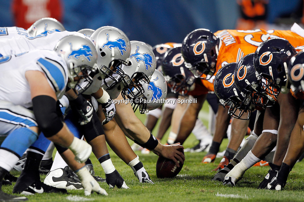 The Detroit Lions offense gets set to snap the ball while lined up opposite the Chicago Bears defense on the line of scrimmage during the NFL week 10 football game against the Chicago Bears on Sunday, November 13, 2011 in Chicago, Illinois. The Bears won the game 37-13. ©Paul Anthony Spinelli