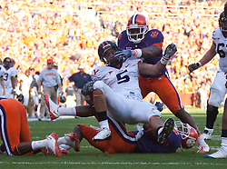 November 21, 2009; Clemson, SC, USA;  Virginia Cavaliers running back Mikell Simpson (5) is stopped short of the end zone by Clemson Tigers safety DeAndre McDaniel (2) during the first quarter at Memorial Stadium.  Clemson defeated Virginia 34-21.