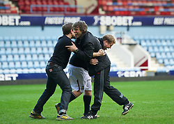 LONDON, ENGLAND - Sunday, February 27, 2011: Liverpool commedian John Bishop and West Ham United supporter James Corden have a kick-about on the pitch after the Premiership match between West Ham United and Liverpool at Upton Park. (Photo by David Rawcliffe/Propaganda)
