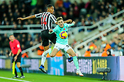 David Brooks (#20) of Bournemouth and Isaac Hayden (#14) of Newcastle United battle for the ball in the air during the Premier League match between Newcastle United and Bournemouth at St. James's Park, Newcastle, England on 10 November 2018.