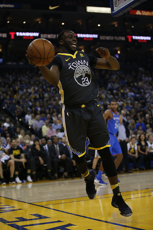 Golden State Warriors forward Draymond Green (23) saves the ball during the first half of an NBA game between the Warriors and Oklahoma City Thunder at Oracle Arena, Tuesday, Feb. 6, 2018, in Oakland, Calif.