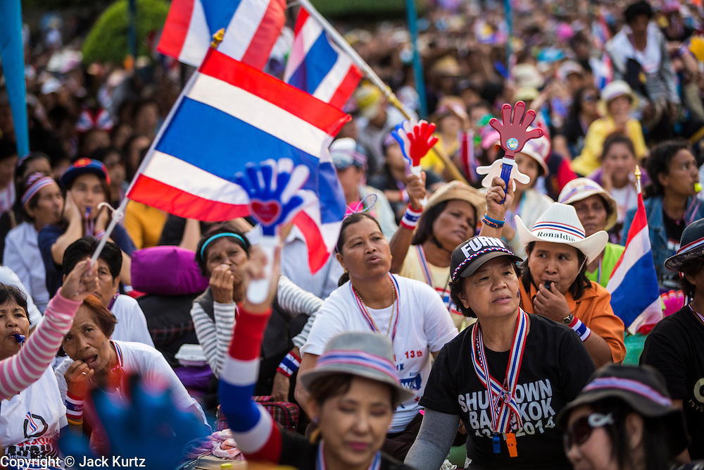 "13 JANUARY 2014 - BANGKOK, THAILAND: Anti-government protestors in Lumpini Park in Bangkok. Tens of thousands of Thai anti-government protestors took to the streets of Bangkok Monday to shut down the Thai capitol. The protest was called ""Shutdown Bangkok"" and is expected to last at least a week. The Shutdown Bangkok protest is a continuation of protests that started in early November. There have been shootings almost every night at different protests sites around Bangkok, including two Sunday night, but the protests Monday were peaceful. The malls in Bangkok stayed open Monday but many other businesses closed for the day and mass transit was swamped with both protestors and people who had to use mass transit because the roads were blocked.    PHOTO BY JACK KURTZ"