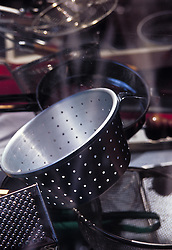 Restaurant kitchen supply store display window collander pots pans