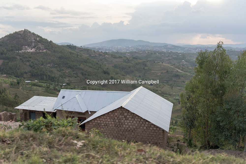 KAMONYI, RWANDA-OCT 11:  New homes and new metal roofs on homes in the Kamonyi Sector of real Rwanda. The building reflects the improved economy that has seen a 6-8 per cent growth rate since 2003. 35 per cent of the population still live under the poverty line. .  (Photo by William Campbell-Corbis via Getty Images)