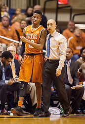 Jan 20, 2016; Morgantown, WV, USA; Texas Longhorns head coach Shaka Smart talks to guard Kerwin Roach Jr. (12) on the bench during the first half against the West Virginia Mountaineers at the WVU Coliseum. Mandatory Credit: Ben Queen-USA TODAY Sports