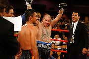 Steven St. John/Tribune..Johnny Tapia raises his arms in victory while looking at his opponent Evaristo Primero on Friday night, Feb. 22, 2007 at Isleta Casino.
