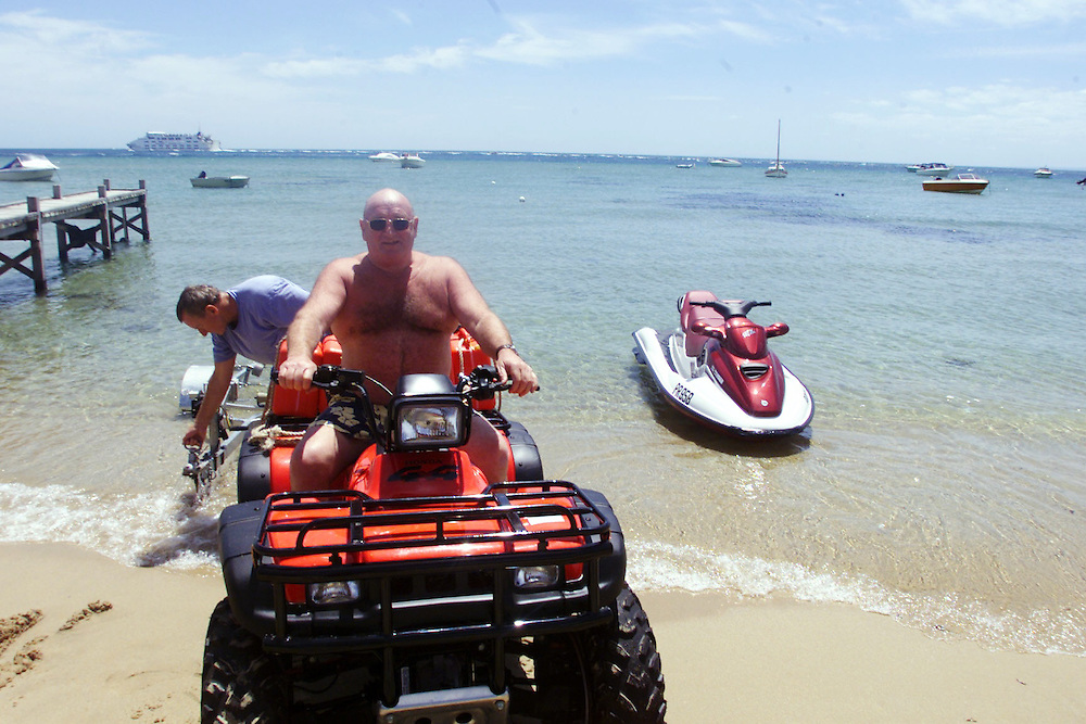 DIGICAM 00004601 csz000107.001.001.jpg. Digicam 00004601. Victoria in the holiday season. Trucking magnate Lindsay Fox on holidays at his Portsea home preparing to go riding his seadoo with his friend Rob Fildes. picture by CRAIG SILLITOE melbourne photographers, commercial photographers, industrial photographers, corporate photographer, architectural photographers, This photograph can be used for non commercial uses with attribution. Credit: Craig Sillitoe Photography / http://www.csillitoe.com<br />