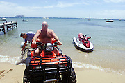 DIGICAM 00004601 csz000107.001.001.jpg. Digicam 00004601. Victoria in the holiday season. Trucking magnate Lindsay Fox on holidays at his Portsea home preparing to go riding his seadoo with his friend Rob Fildes. picture by CRAIG SILLITOE melbourne photographers, commercial photographers, industrial photographers, corporate photographer, architectural photographers, This photograph can be used for non commercial uses with attribution. Credit: Craig Sillitoe Photography / http://www.csillitoe.com<br /> <br /> It is protected under the Creative Commons Attribution-NonCommercial-ShareAlike 4.0 International License. To view a copy of this license, visit http://creativecommons.org/licenses/by-nc-sa/4.0/.