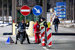 Police officers and medics check travelers at the border crossing with Italy upon entry into Slovenia next to town Ratece, on March 12, 2020 in Ratece, Slovenia. Photo by Matic Klansek Velej / Sportida