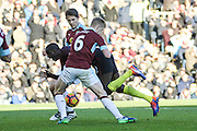 Burnley defender Ben Mee (6) and Manchester City midfielder Yaya Toure battle during the Premier League match between Burnley and Manchester City at Turf Moor, Burnley, England on 26 November 2016. Photo by Pete Burns.