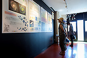 Tourist interact with information in a visitors centre in Nobeyama Radio Observatory (NRO) near Minamimaki, Nagano, Japan Wednesday August 17th 2016. The NRO is a project run by the National Astronomical Observatory of Japan (NAOJ), and the institute of the National Institute of Natural Sciences (NINS). The site, operates powerful, advanced radio telescopes, including a 45-m Radio Telescope (one of the world's largest),The Nobeyama Radio Polarimeter, and the 6 antenna Nobeyama millimetre array.