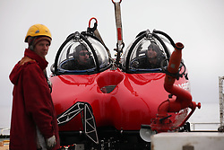USA ALASKA BERING SEA 11JUL12 - Pilots Shannon Lo Ricco of Australia and John Hocevar of the USA get ready for their first dive in a two-seater submersible craft, on loan from the Waitt Institute is prepared on board the Greenpeace ship Esperanza for its first dive exploring the deep sea canyons of the Bering Sea, Alaska.....The Greenpeace ship Esperanza is on an Arctic expedition to study unexplored ocean habitats threatened by offshore oil drilling, as well as industrial fishing fleets.....Photo by Jiri Rezac / Greenpeace....© Jiri Rezac / Greenpeace