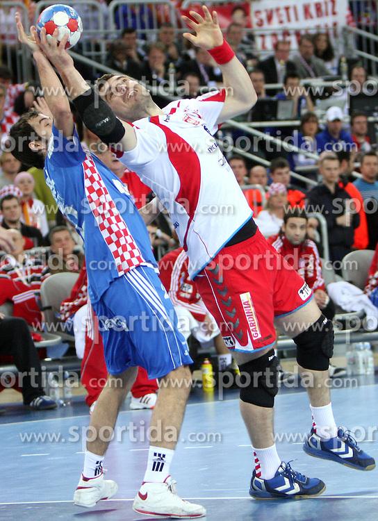Mateo Hrvatin (2) of Croatia vs Bartosz Jurecki (13) of Poland during 21st Men's World Handball Championship 2009 semifinals match between National teams of Poland and Croatia, on January 30, 2009, in Arena Zagreb, Zagreb, Croatia.  (Photo by Vid Ponikvar / Sportida)