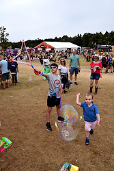 Latitude Festival 2017, Henham Park, Suffolk, UK. Children playing with bubbles