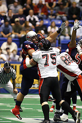 14 April 2007: Barry Brueggeman applys a face mask to Chris Burgess who is going up for a block attempt during a United Indoor Football League game that pitted the RiverCity Rage who won 29-11 against the Bloomington Extreme at the U.S. Cellular Coliseum in Bloomington Illinois..