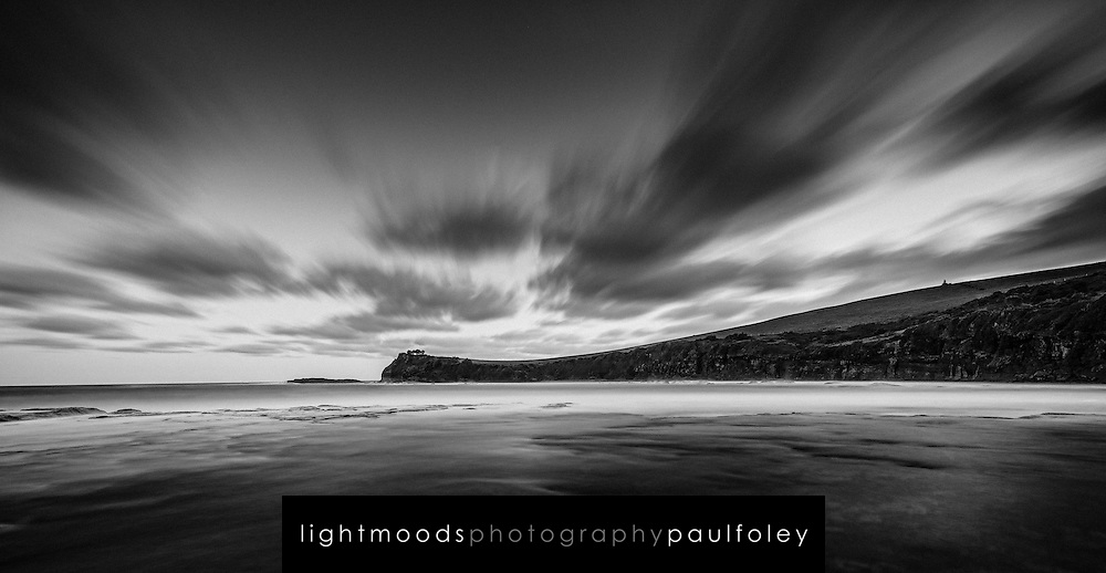A dark and moody boat harbour at Gerringong, South Coast, NSW, Australia.