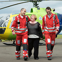SCAA...Scotland's Charity Air Ambulance Paramedics re-united with first casualty....26.06.13<br /> 59 year old Patricia MacKenzie from Thornliebank in Glasgow visited the base of Helimed 76 in perth today to thank the two paramedics John Pritchard (left) and Wayne Auton who airlifted Patricia to hospital after her accident near Cairndow in Argyll five weeks ago.<br /> Picture by Graeme Hart.<br /> Copyright Perthshire Picture Agency<br /> Tel: 01738 623350  Mobile: 07990 594431