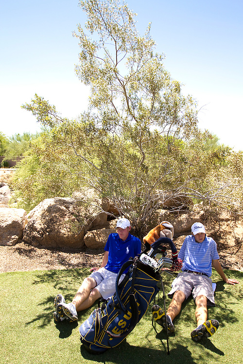 American Junior Golf Association player Grayson Murray and Jordan Spieth don't have caddies to hold umbrellas for shade. They find respite in the shadows of a shrub at the Thunderbird International Junior tournament.