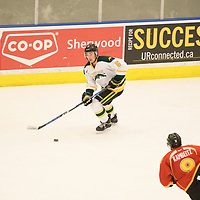 3rd year defence man Jordan Burns (5) of the Regina Cougars in action during the Men's Hockey home game on February 3 at Co-operators arena. Credit: Arthur Ward/Arthur Images