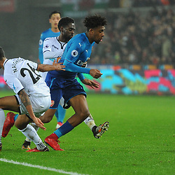 Alex Iwobi of Arsenal is challenged by Kyle Naughton of Swansea City during Swansea City vs Arsenal, Premier League, 30.01.18 (c) Harriet Lander | SportPix.org.uk