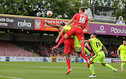 Dave winfield wins the header during the Sky Bet League 2 match between York City and Hartlepool United at Bootham Crescent, York, England on 15 August 2015. Photo by Simon Davies.