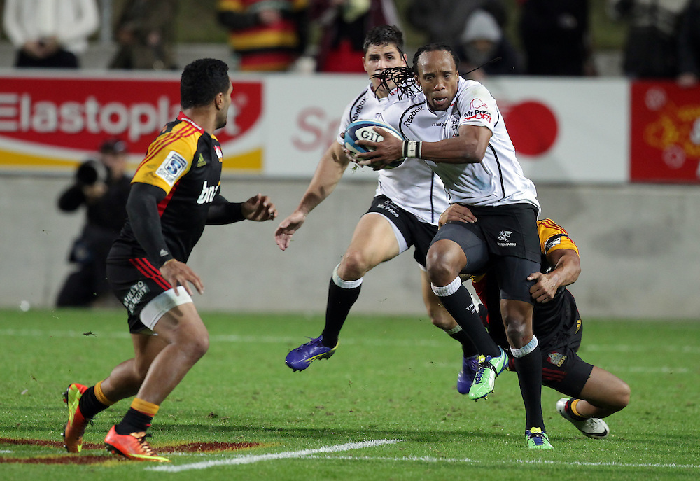 Sharks' Odwa Ndungane is tackled by Chiefs' Tim Nanai-Williams in a Super Rugby match, Waikato Stadium, Hamilton, New Zealand, Saturday, April 27, 2013.  Credit:SNPA / David Rowland