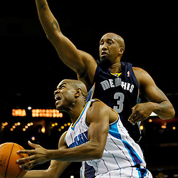 December 21, 2011; New Orleans, LA, USA; New Orleans Hornets point guard Jarrett Jack (2) shoots as Memphis Grizzlies forwardcenter Brian Skinner (3) defends during the first quarter of a game at the New Orleans Arena.   Mandatory Credit: Derick E. Hingle-US PRESSWIRE