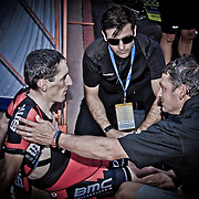 BMC Racing's Marco Pinotti is comforted by his Team Directors after suffering heat exhaustion from climbing up the Palm Springs Aerial Tramway in 114 degree heat at the 2013 Amgen Tour of California.