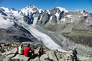 "Above Morteratsch Glacier rise Piz Bernina (4049 m) and Piz Morteratsch in Graubünden (or Grisons / Grigioni / Grischun) canton of Switzerland, the Alps, Europe. From Diavolezza cable car station, admire tremendous views of the icy Bernina Range. If not afraid of heights at Diavolezza, don't miss the magnificent hike to rocky Munt Pers (gaining 265 meters over just 4 km round trip). The Swiss valley of Engadine translates as the ""garden of the En (or Inn) River"" (Engadin in German, Engiadina in Romansh, Engadina in Italian) and is part of the Danube basin."