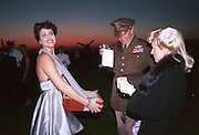 Cigarett girl at the Goodwood Revival Meeting Ball. 19 September 1998. © Copyright Photograph by Dafydd Jones 66 Stockwell Park Rd. London SW9 0DA Tel 020 7733 0108 www.dafjones.com