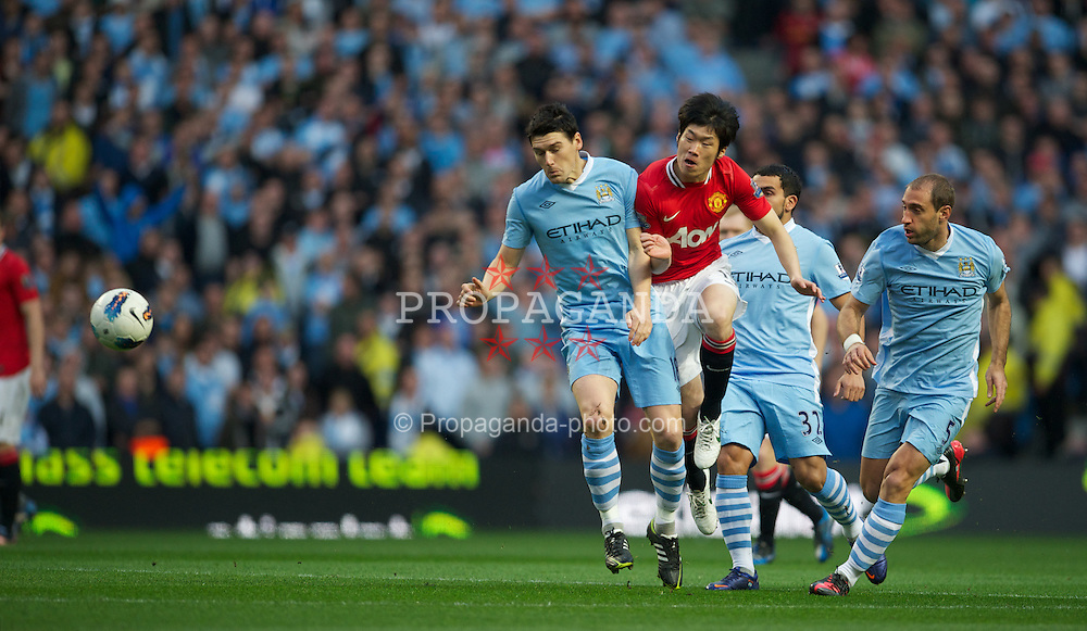MANCHESTER, ENGLAND - Monday, April 30, 2012: Manchester City's Gareth Barry in action against Manchester United's Park Ji-Sung during the Premiership match at the City of Manchester Stadium. (Pic by David Rawcliffe/Propaganda)