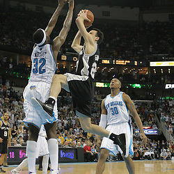 29 March 2009: San Antonio Spurs guard Manu Ginobili (20) drives to the basket as New Orleans Hornets forward Julian Wright (32) defends on the play during a 90-86 victory by the New Orleans Hornets over Southwestern Division rivals the San Antonio Spurs at the New Orleans Arena in New Orleans, Louisiana.