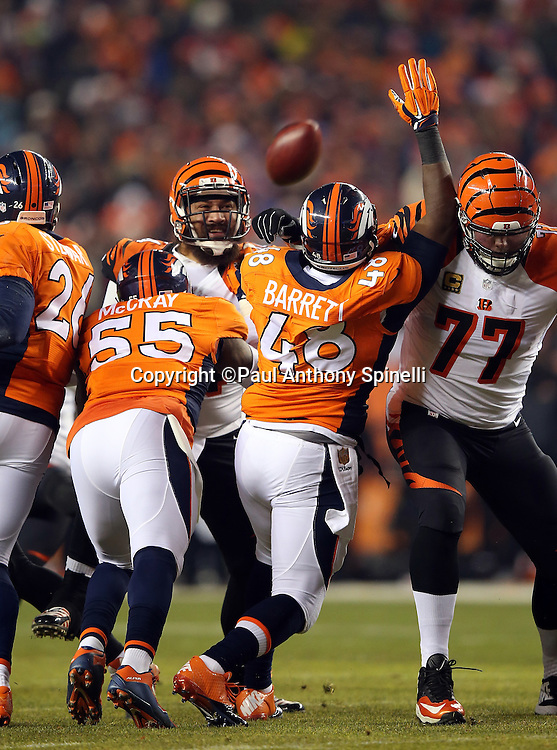 Denver Broncos outside linebacker Lerentee McCray (55) and Denver Broncos long snapper Aaron Brewer (46) try to block a first quarter extra point that gives the Cincinnati Bengals a 7-0 lead during the 2015 NFL week 16 regular season football game against the Cincinnati Bengals on Monday, Dec. 28, 2015 in Denver. The Broncos won the game in overtime 20-17. (©Paul Anthony Spinelli)
