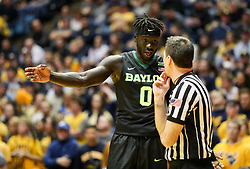 Jan 9, 2018; Morgantown, WV, USA; Baylor Bears forward Jo Lual-Acuil Jr. (0) talks to a referee during the first half against the West Virginia Mountaineers at WVU Coliseum. Mandatory Credit: Ben Queen-USA TODAY Sports