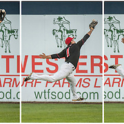 In this three photo sequence,the Vancouver Canadians outfielder, Chris Carlson, drops the ball while trying to make a running catch vs. the Spokane Indians in game one of the NorthWest League divisional play-offs.  Vancouver won 1-0