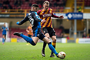 Swindon Town Defender Raphael Rossi Branco (29) clears the ball from Bradford City Forward Charlie Wyke (9) during the EFL Sky Bet League 1 match between Bradford City and Swindon Town at the Coral Windows Stadium, Bradford, England on 18 March 2017. Photo by Craig Zadoroznyj.