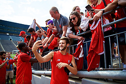 ANN ARBOR, USA - Friday, July 27, 2018: Liverpool's Adam Lallana takes a selfie with a supporter's iPhone after a training session ahead of the preseason International Champions Cup match between Manchester United FC and Liverpool FC at the Michigan Stadium. (Pic by David Rawcliffe/Propaganda)