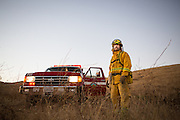 Milpitas resident and Spring Valley Fire Department volunteer Howard Hall poses for a portrait outside his home in the Calaveras Hills, Milpitas, Calif., on Aug. 5, 2012.  Hall has been a volunteer firefighter with the Spring Valley Fire Department since 1984.  Hall's home is used as a staging area and houses three fire apparatus, including one engine, a patrol truck, and a 1,500 gallon water tanker.  Photo by Stan Olszewski/SOSKIphoto.