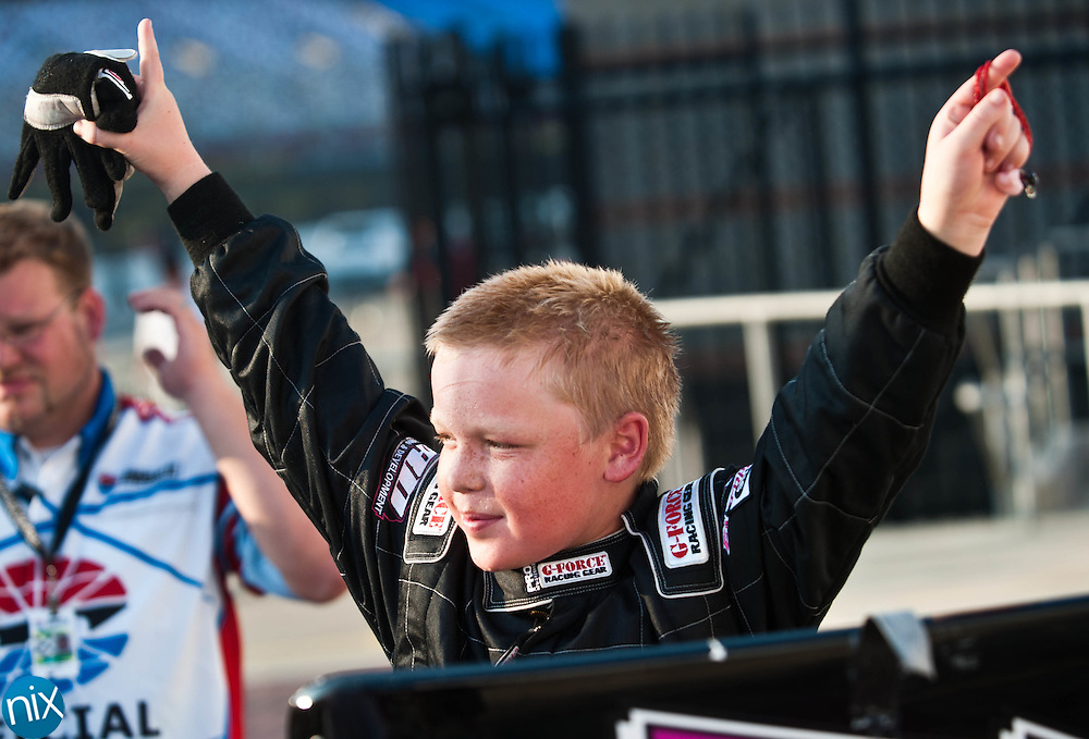 Bandolero Beginner Bandits driver Hunter Stewart celebrates after winning his feature race during the Summer Shootout Series final at Charlotte Motor Speedway Tuesday night. (Photo by James Nix)