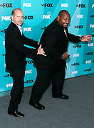 Actors Mike Henry and Kevin Michael Richardson pose at the Fox 2009 Programming Presentation Post-Party Arrivals at Wollman Rink in New York City, USA on May 18, 2009.