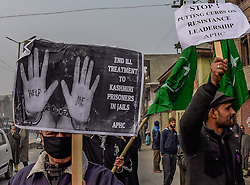 December 10, 2016 - Srinagar, Jammu and Kashmir, India - Leaders and activists of the All Parties Hurriyat Conference (APHC) , an amalgam of pro- Kashmir resistance organizations, shout anti Indian slogans during a protest to mark the World Human Rights Day on December 10, 2016 in Srinagar, the summer capital of Indian administered Kashmir, India.Indian government forces in Kashmir are often blamed for grave rights abuses like widespread torture, rape, custodial murder and enforced disappearances in the Muslim-majority region Since 1989, Kashmir has been a state under siege, with both India and Pakistan laying claim to it. Human rights organizations say more than 80,000 have died in the two decade long conflict with the Indian government claiming the number as 40,000. (Credit Image: © Yawar Nazir via ZUMA Wire)