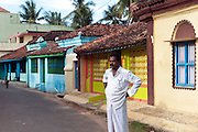 treet in Nagapattinam with row of colourful homes.
