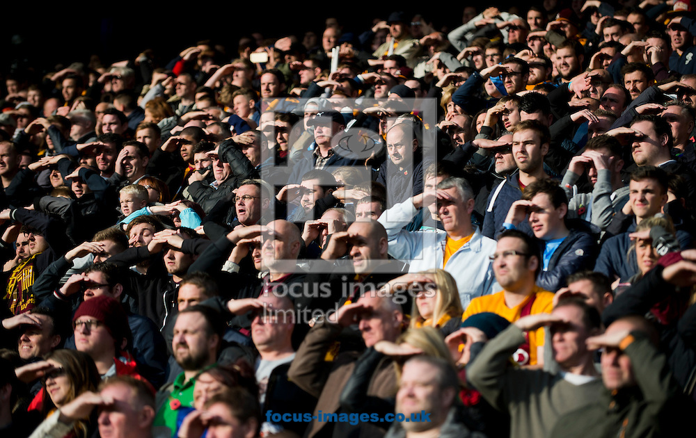 Bradford City fans shield their eyes from the sun during the The FA Cup match at Shay Stadium, Halifax<br /> Picture by Russell Hart/Focus Images Ltd 07791 688 420<br /> 09/11/2014