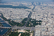 Looking above the Jardin de Tuileries (a public garden located between the Louvre Museum and the Place de la Concorde) and the Champs-Elysees with the Seine river running along the left bank. In the far distance one can see the Arc du Triomphe and the La Defense.