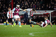 Aston Villa defender Nathan Baker (2) tackling Brentford striker Lasse Vibe (21) during the EFL Sky Bet Championship match between Brentford and Aston Villa at Griffin Park, London, England on 31 January 2017. Photo by Matthew Redman.